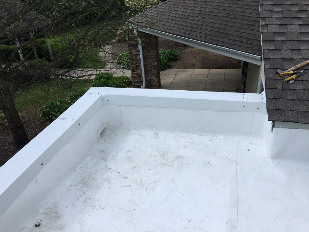 This is an overview of the completed installation of the white TPO membrane roof.