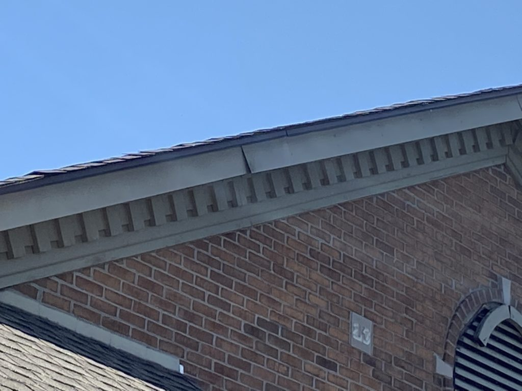 This is a view of gray fascia metal that is pulling away.