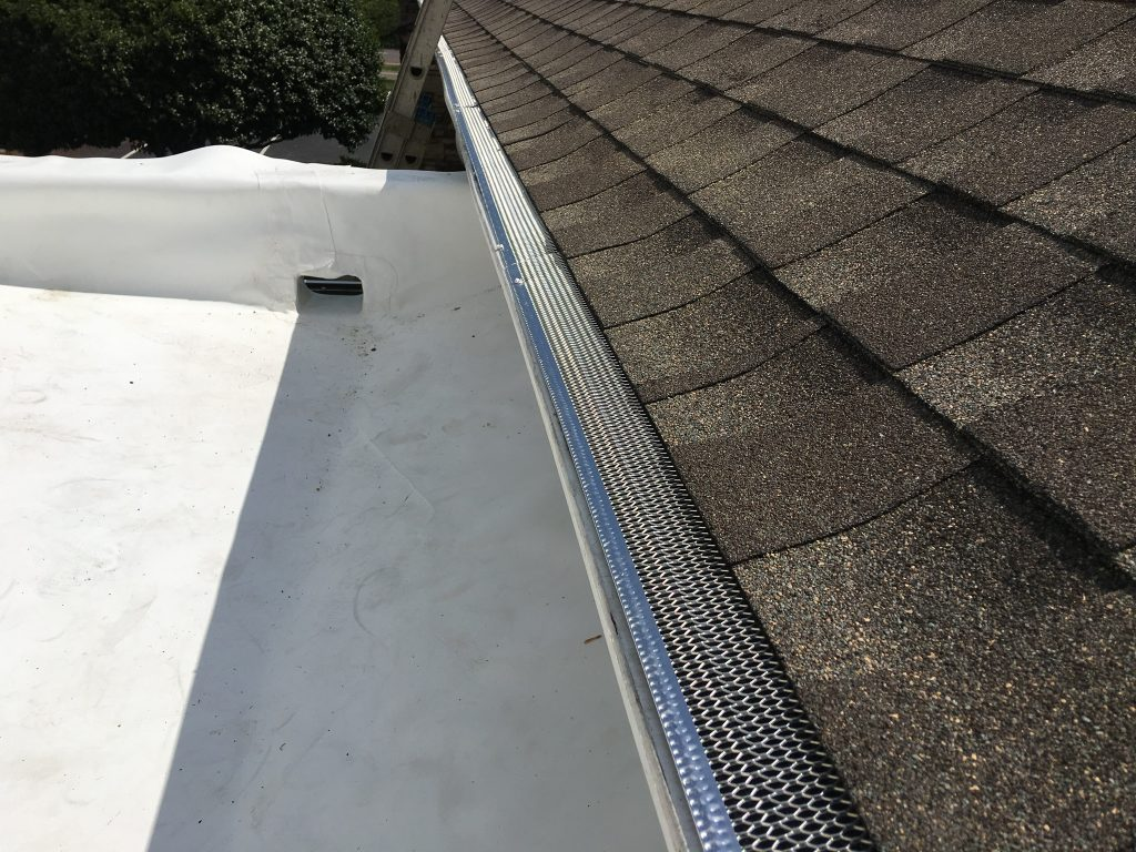 This is a view of white TPO membrane roof installed and the drain cut out.
