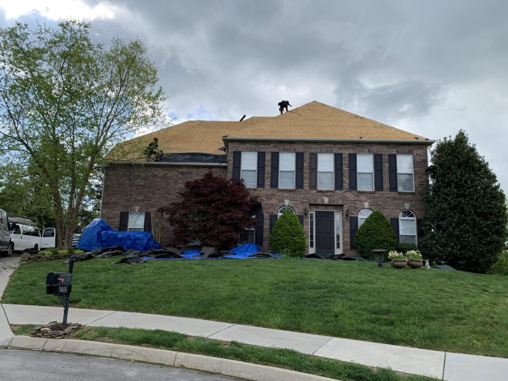 Wind damage roof replacement