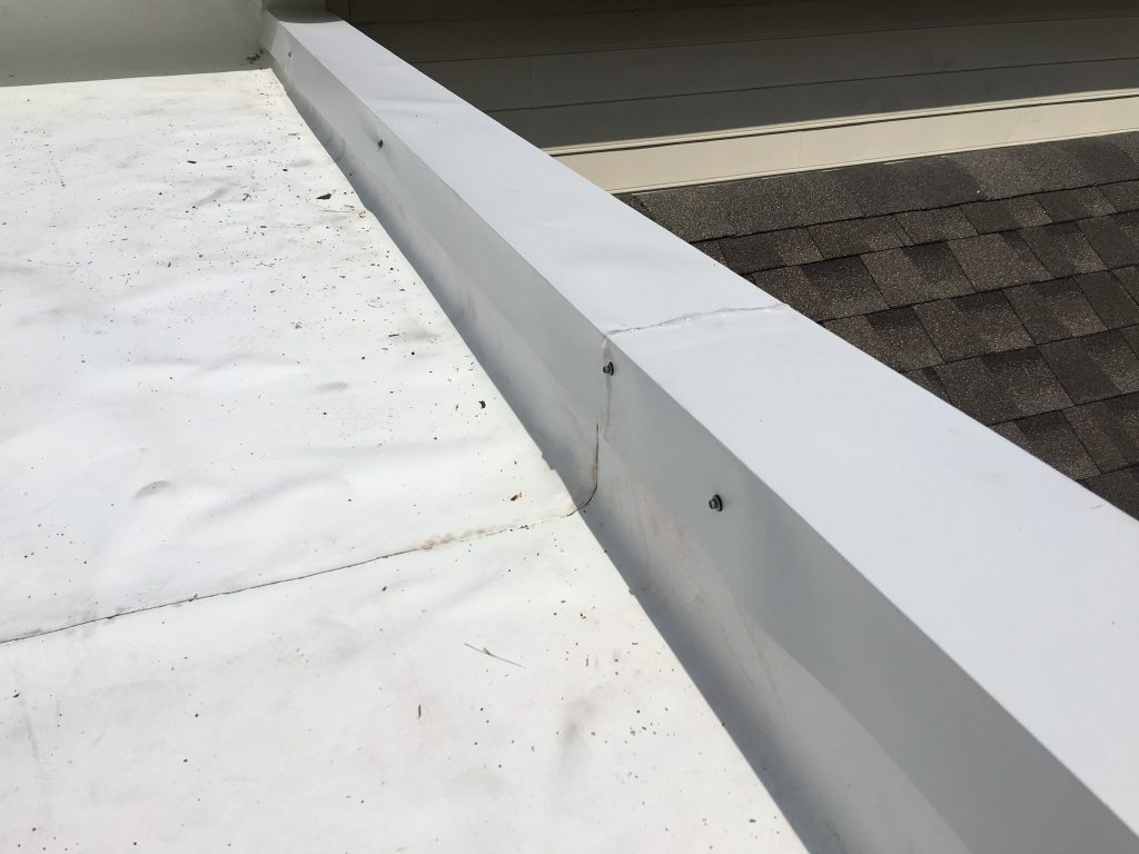 This is a view of the edge of the white TPO membrane roof.