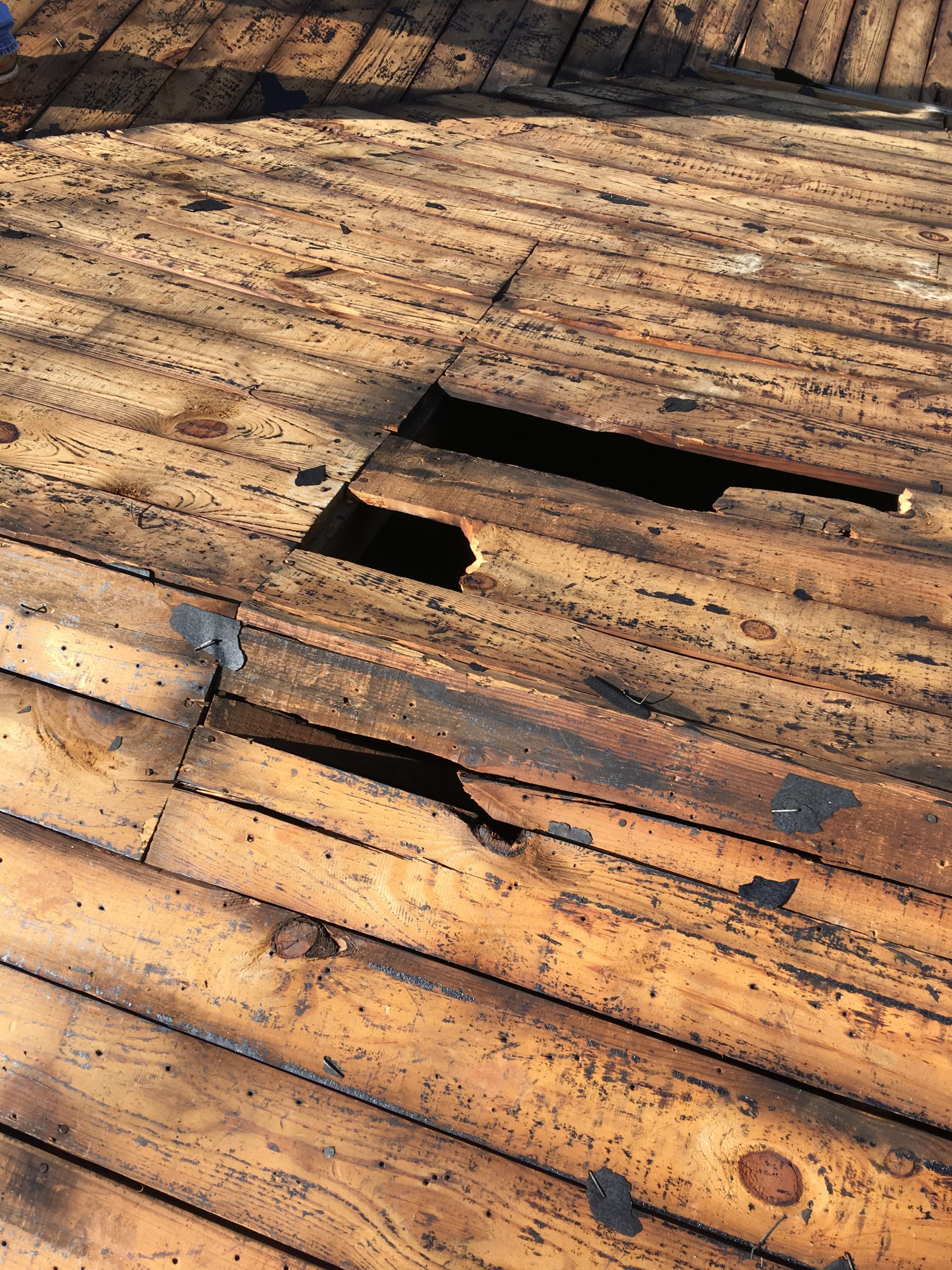This is a view of the deck boards  with areas of missing boards.