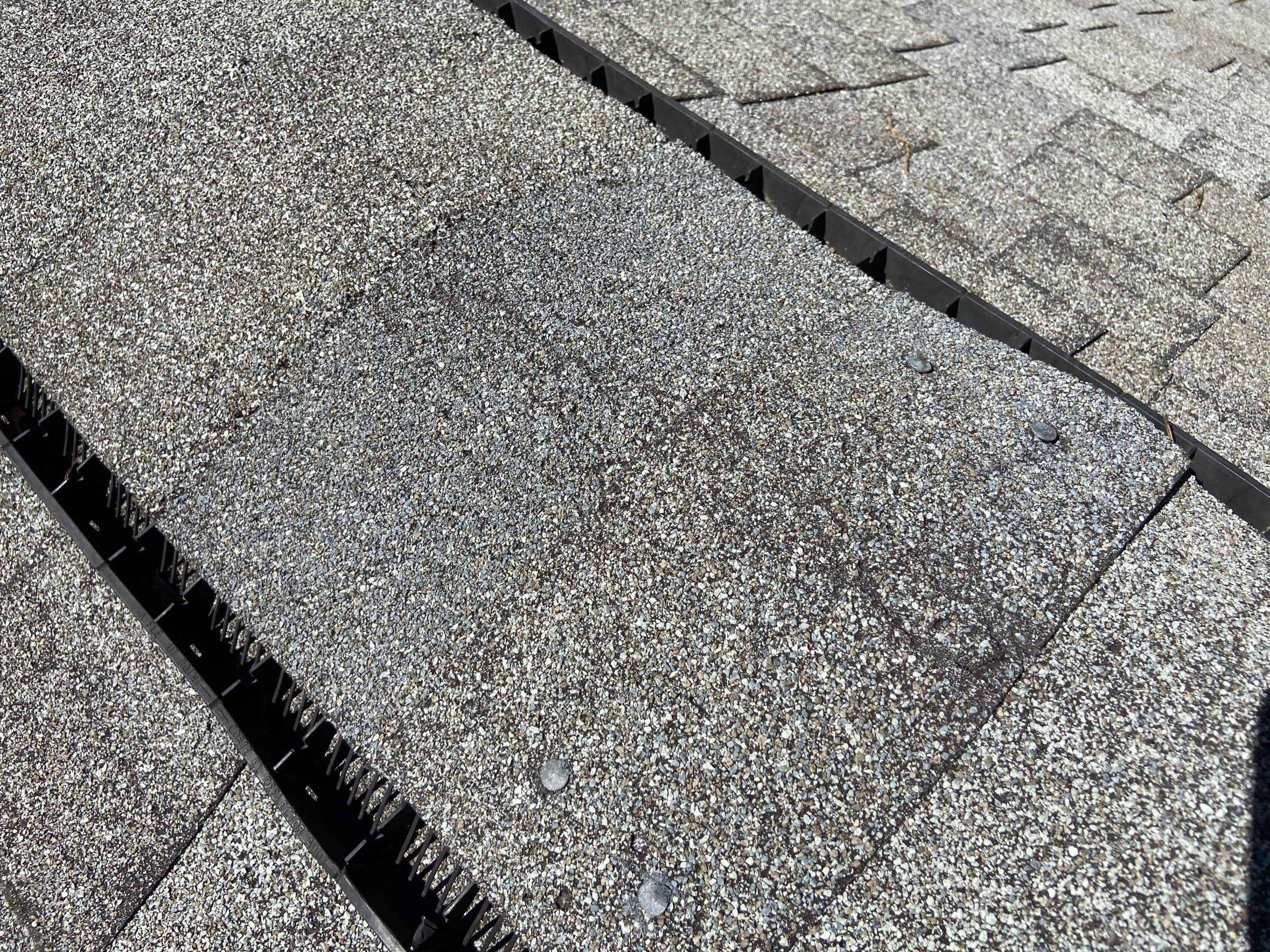 This is an image of ridge cap shingles that are starting to crack.