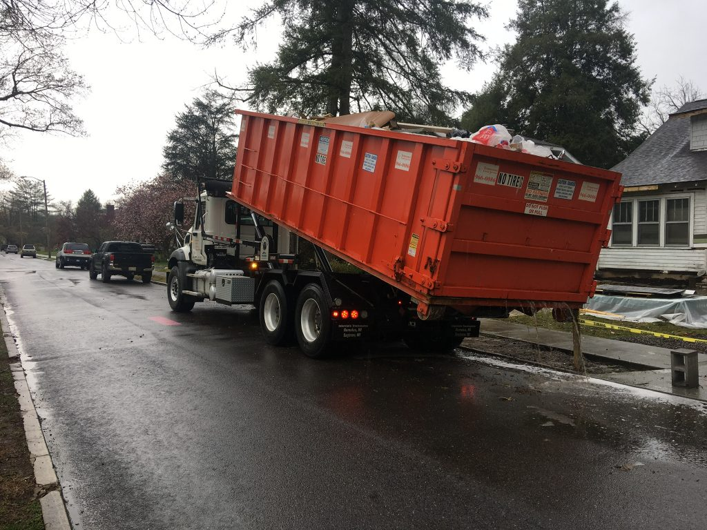 This is a large dumpster that was full of debris and shingles from the roof.