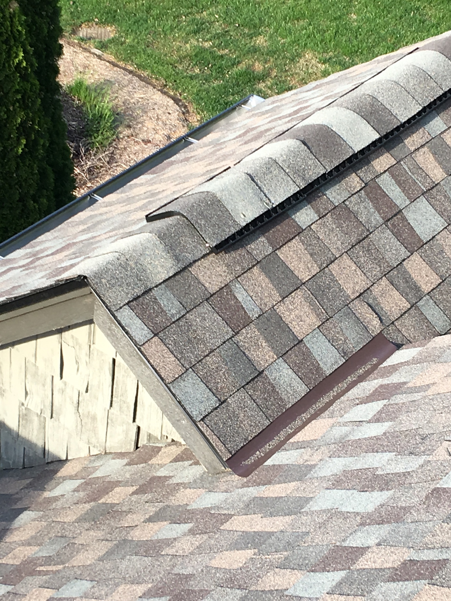 This is the ridge of the roof with ridge cap shingles.