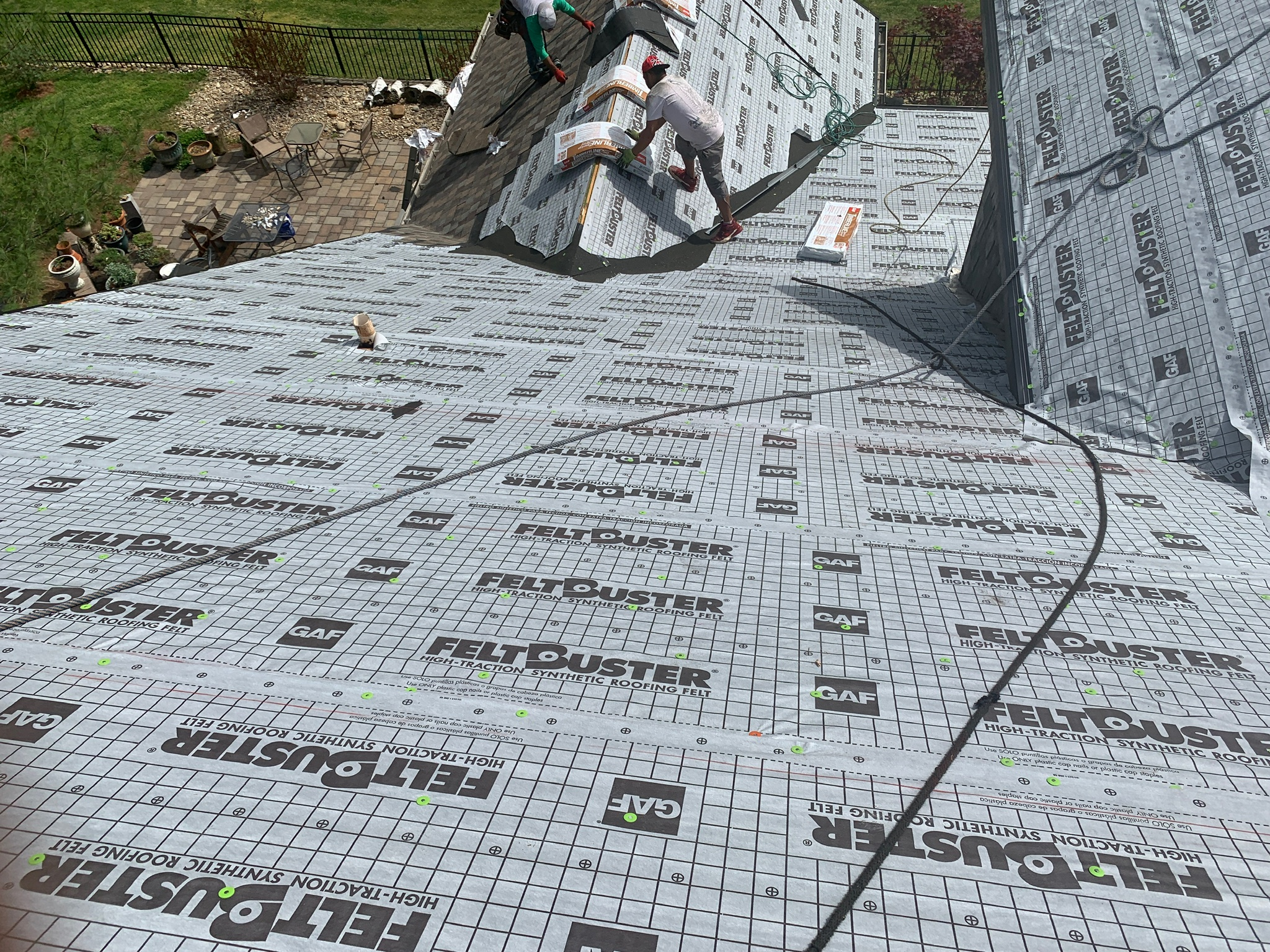 This is a view of GAF Feltbuster being installed on a portion of the roof.