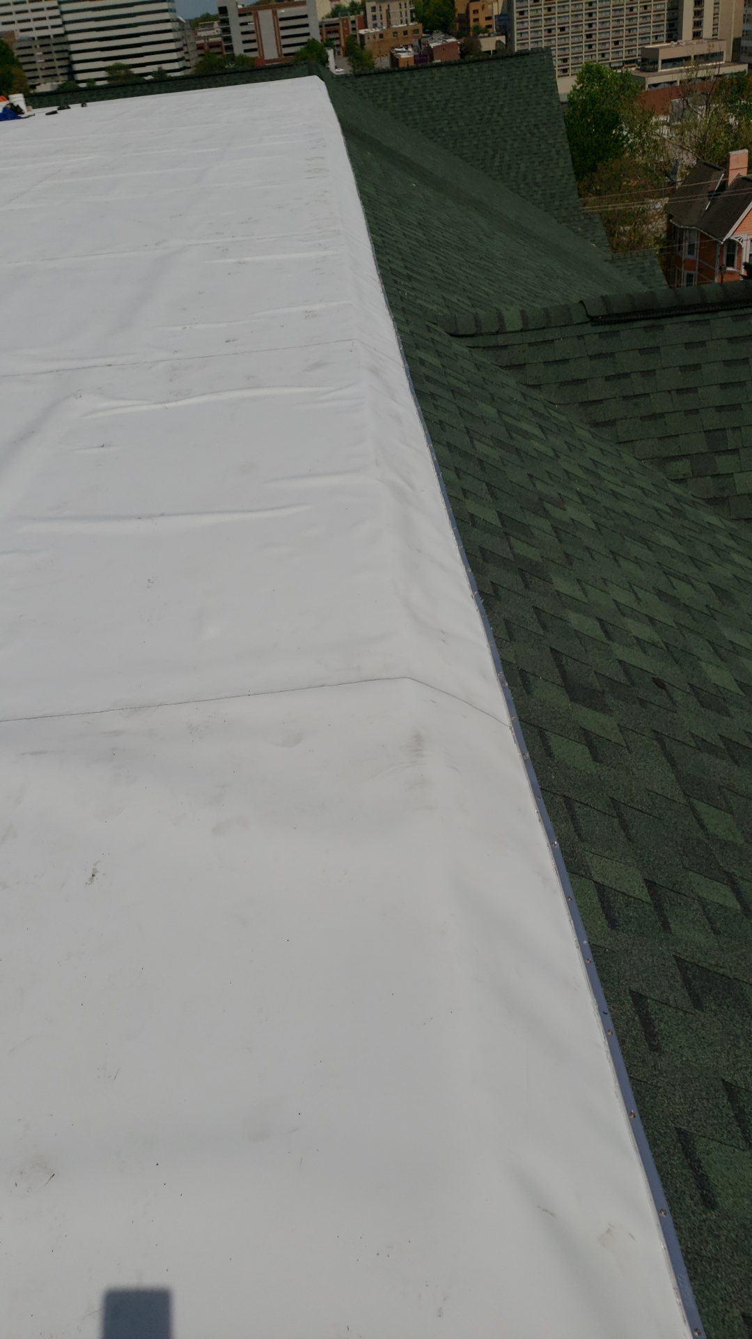 This is the edge of the roof with white TPO.