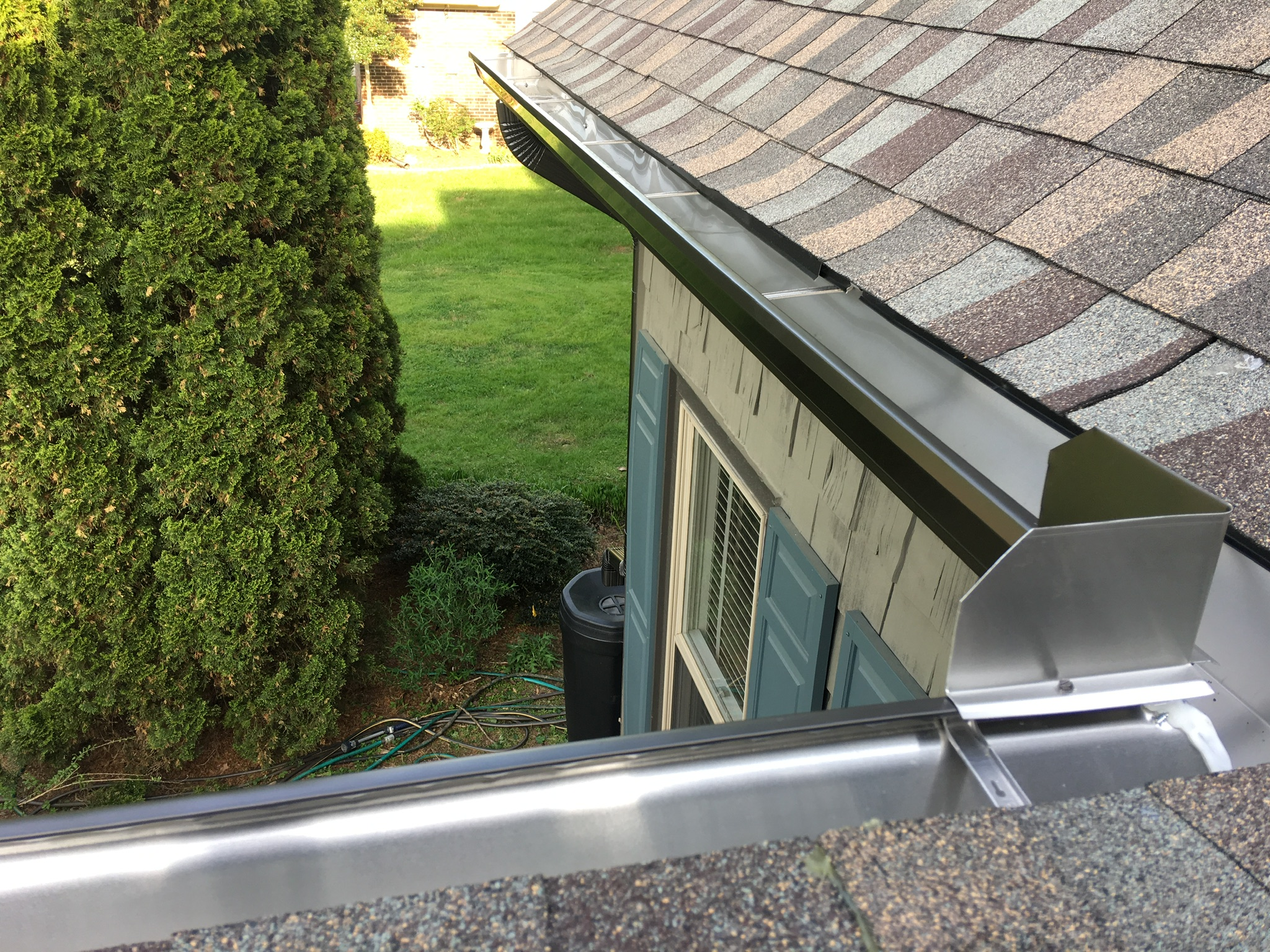 This is a view of the gutters with gutter screens installed to prevent leaves clogging the gutters.