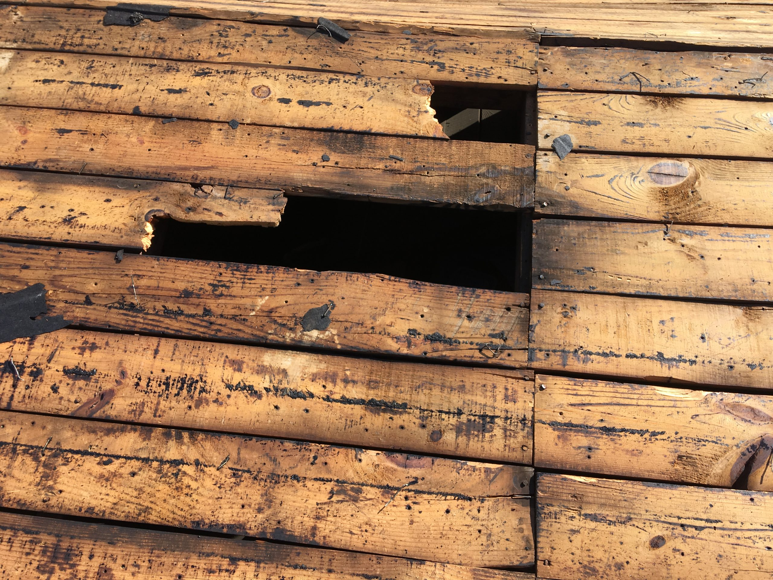 This is a view of missing deck boards on the roof.
