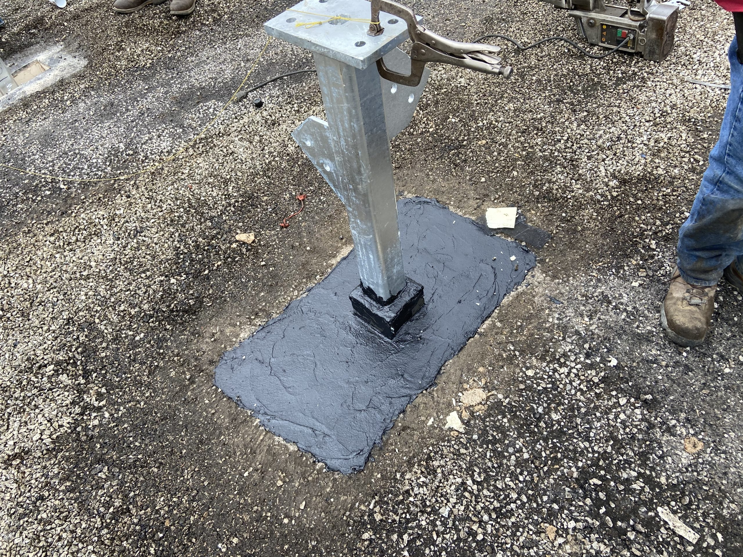 This is a view of a new pitch pocket installed on a chip and tar roof.