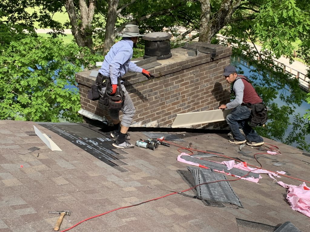 This picture is showing flashing being installed on a chimney.