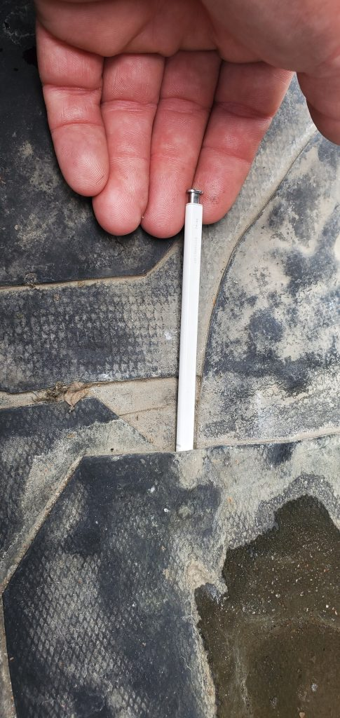This is a picture of black EPDM with a pen inserted in the lap, possible cause of the leak.