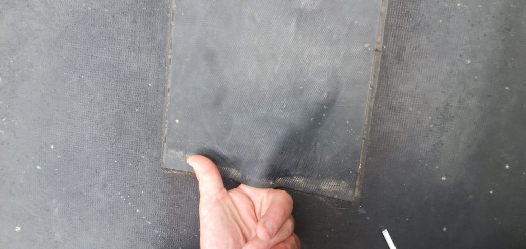 This is an patch on an black EPDM roof that is no longer sealed.