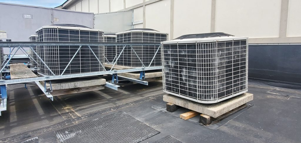 This is a picture of an AC unit that is too low on the roof.