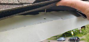 This is a view of white drip edge that was not installed properly.