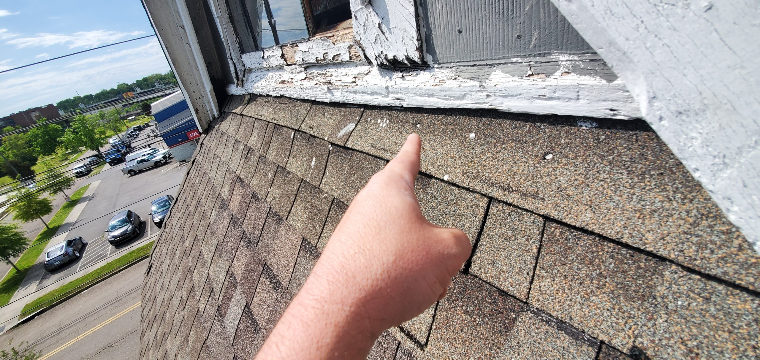 This view shows exposed nails on the shingles.