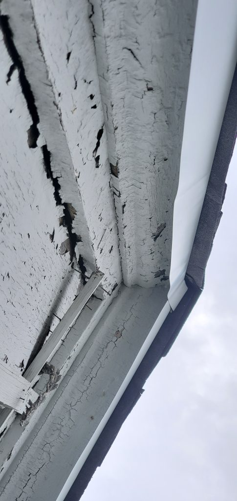 Close up view of white drip edge that was not installed correctly.