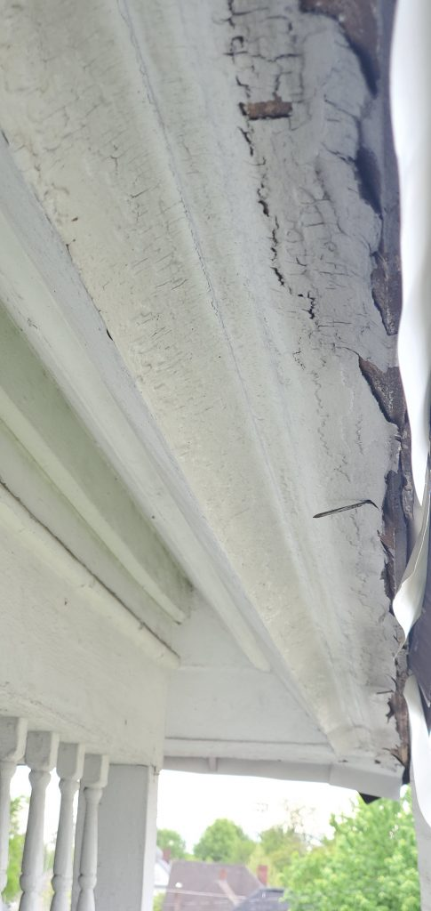 This is a view of white drip edge that is dented and falling off.