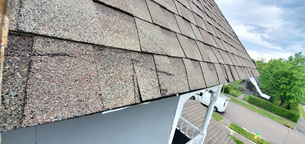 This is a view of white drip edge not attached to the eave of the roof.