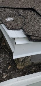 This is a close up of white drip edge that has not been mitered.