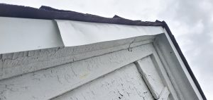 This is white drip edge that has several dents.