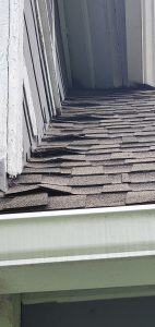 This is a view of shingles buckling on the roof.