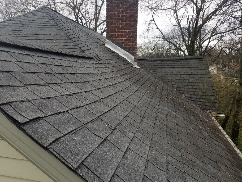 This is a view of newly installed GAF Charcoal shingles and flashing at the chimney.