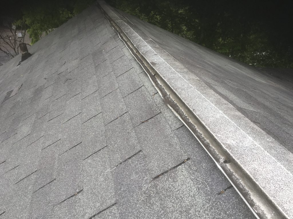 This is a picture of the ridge vent with hail damage.