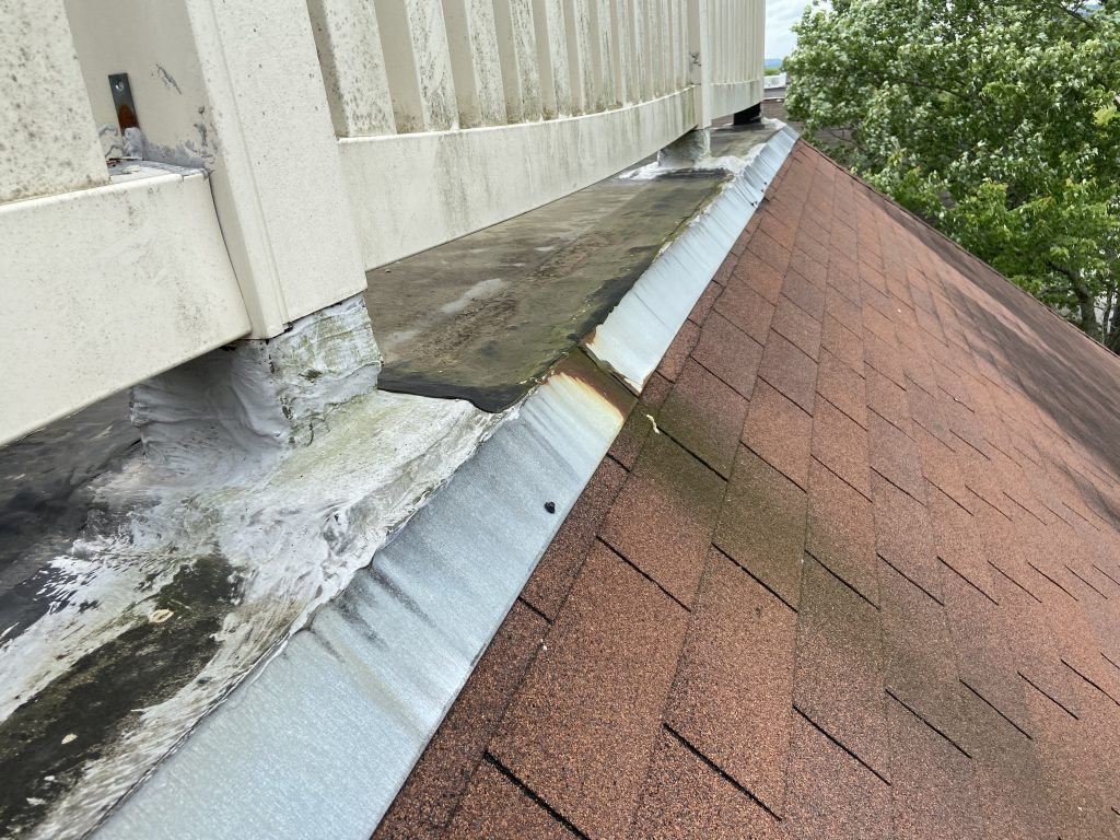 This is the white railing that is loose on the flat roof.