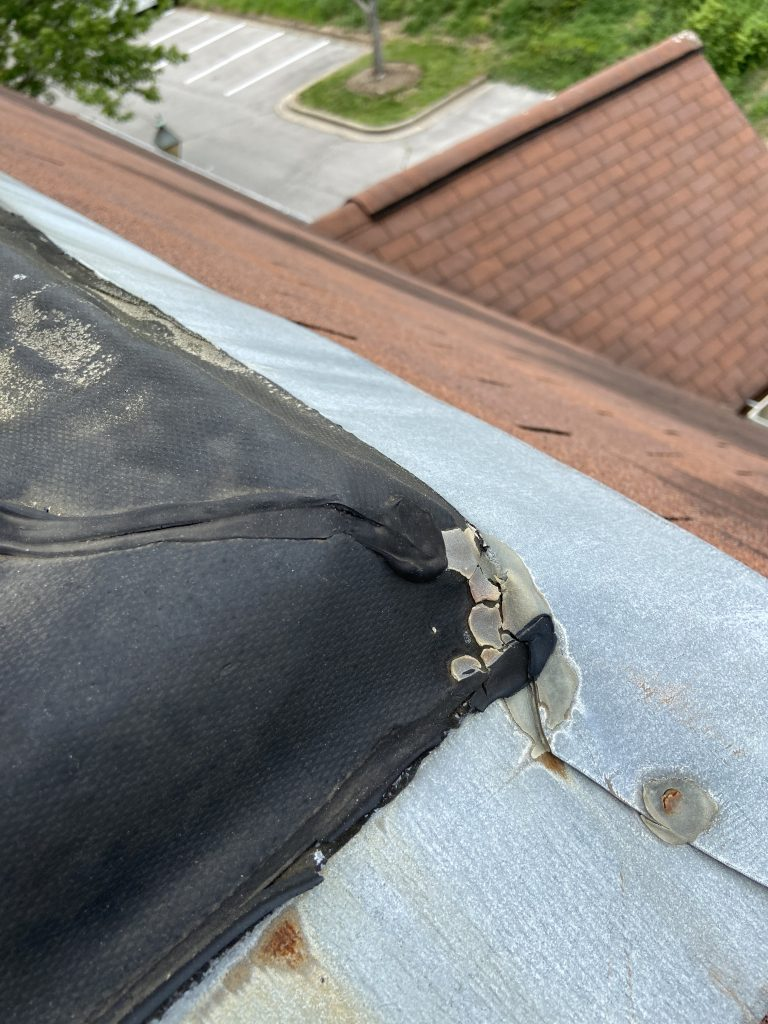 This is an image of the black flat roof material on the roof.