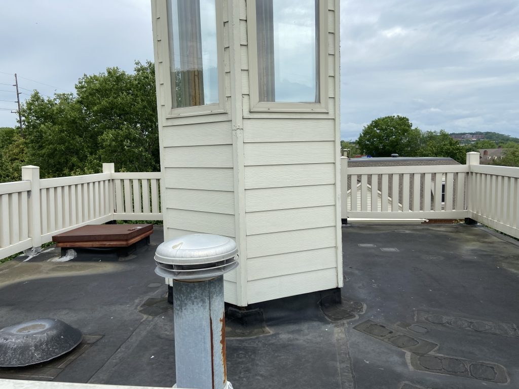 A white cupola that needs repainted and sealed.