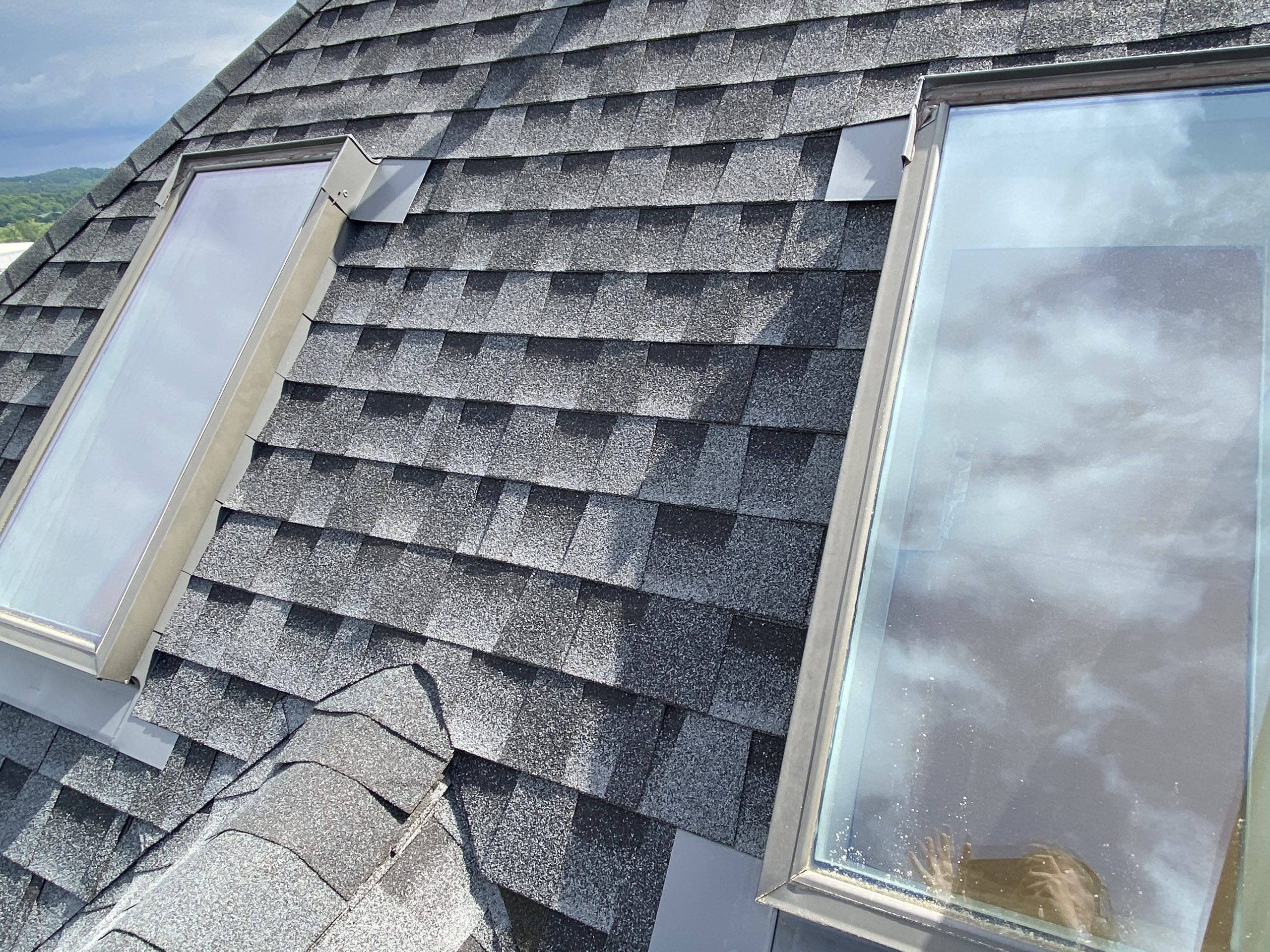 This is a view of skylights on the roof with GAF Charcoal shingles.