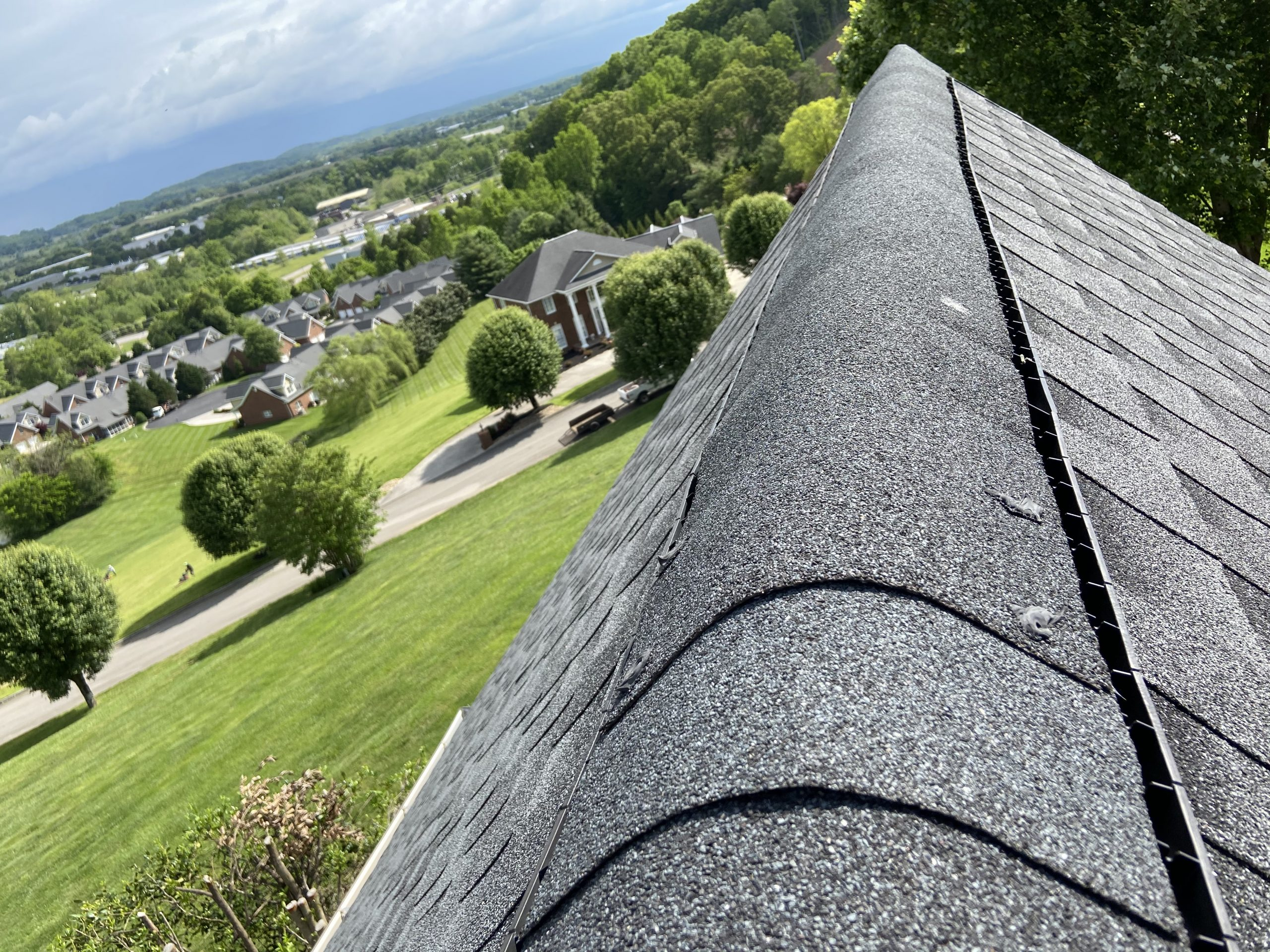 This is the ridge of a high and steep roof showing the ridge cap shingles.
