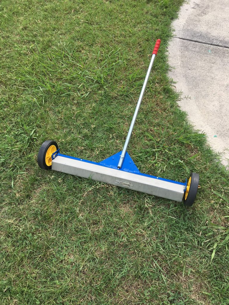 This is a magnet roller that is used to pick up nails from the grass and driveway.