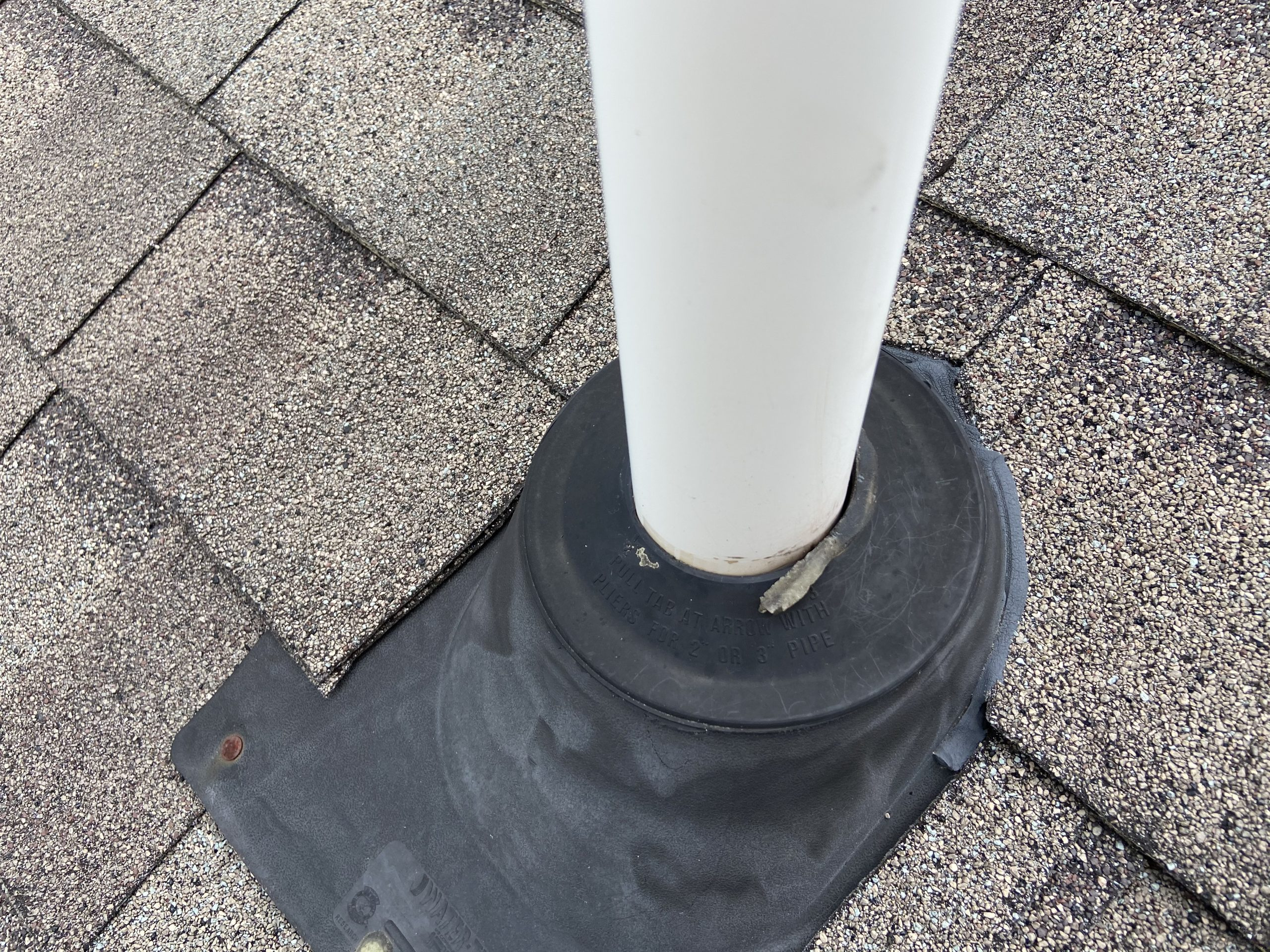 This is a picture of a roofing pipe that is causing leaks and ceiling stains