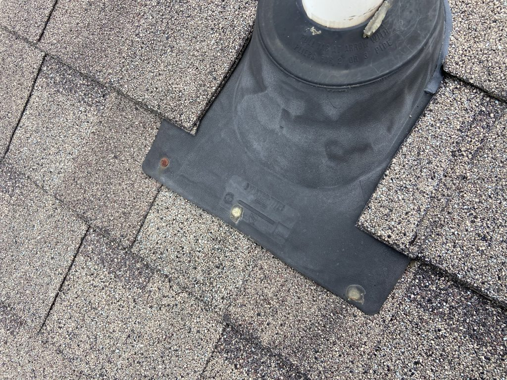 this is a picture of rusty nails on a roof that are holding down a pipe boot