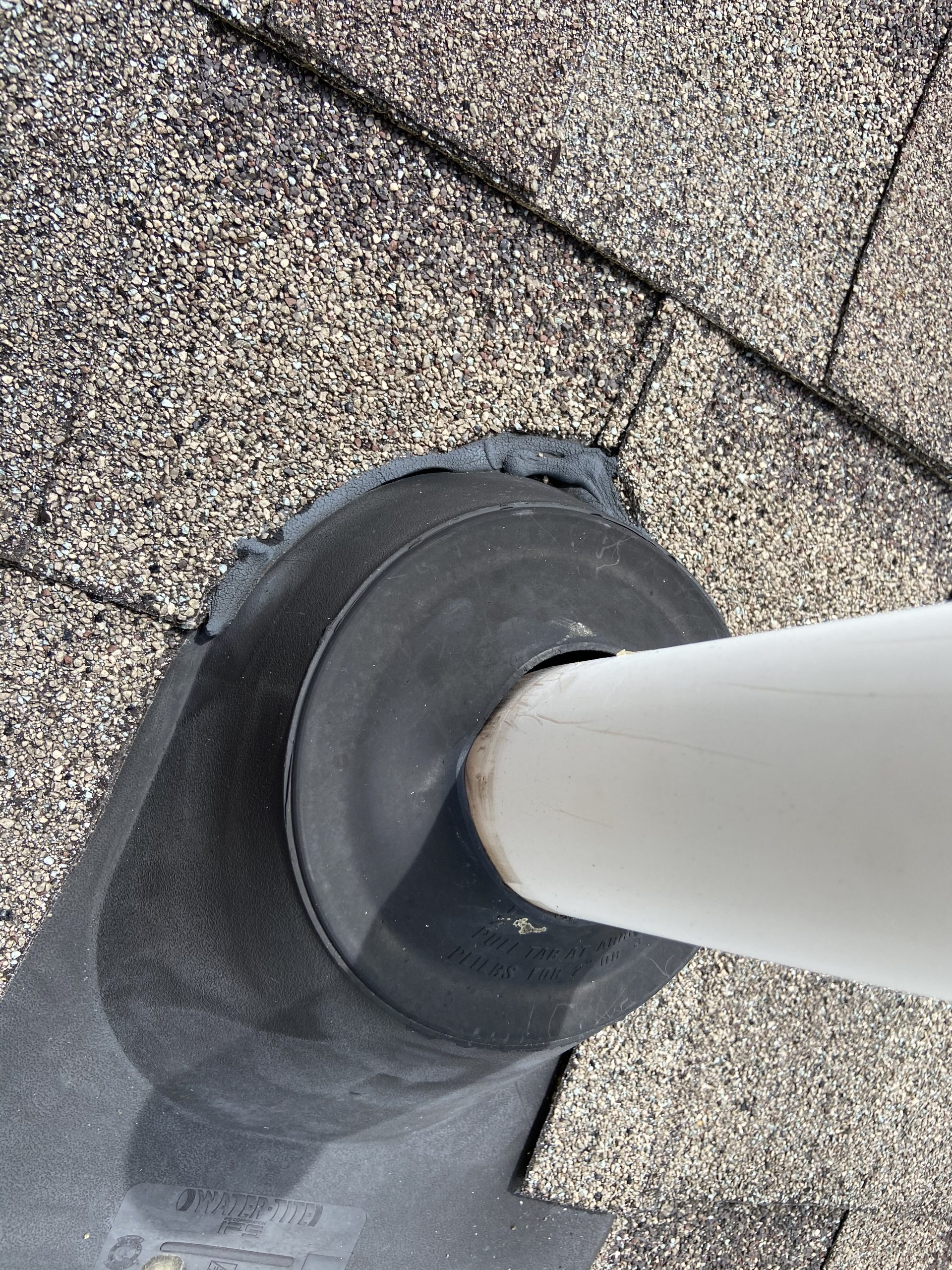 this is a picture of the gaps between a pipe boot and the pipe coming through the roof