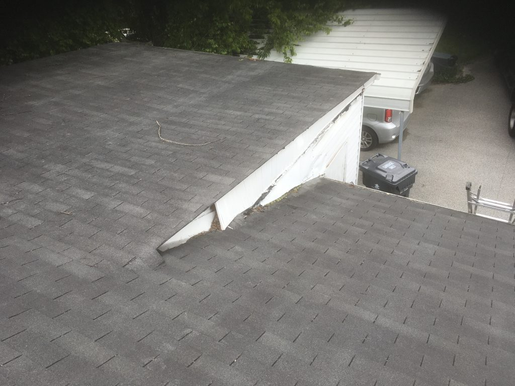 This is a picture of white roof siding that is not in place.