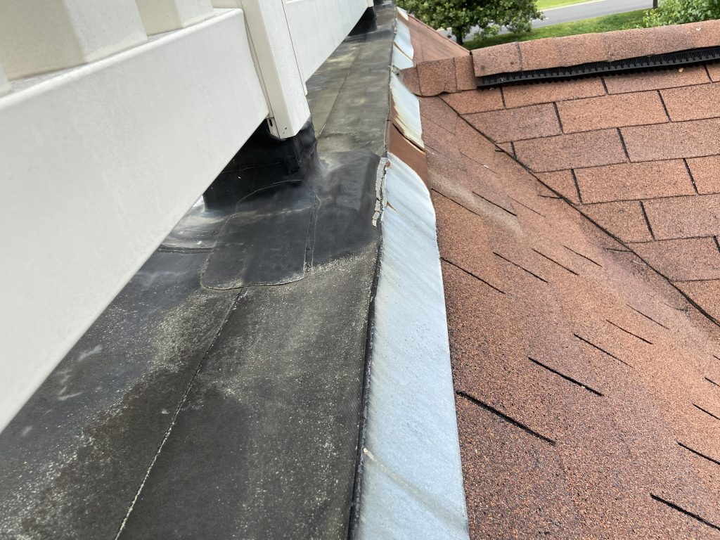 This is an up close image of the white rail on the flat roof.
