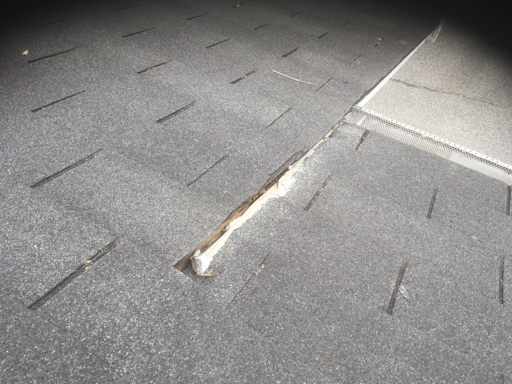 This is a view of roof flashing and gutter guards.