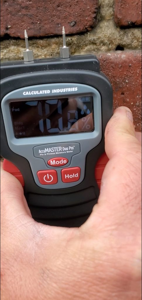 This is a moisture reader detecting moisture behind the brick of a chimney.