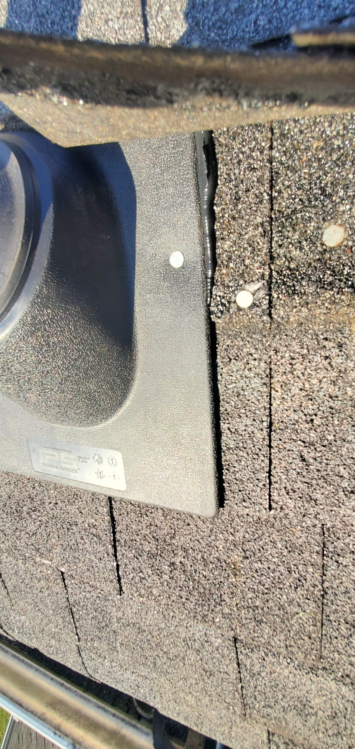A view of a newly installed pipe boot on the roof.