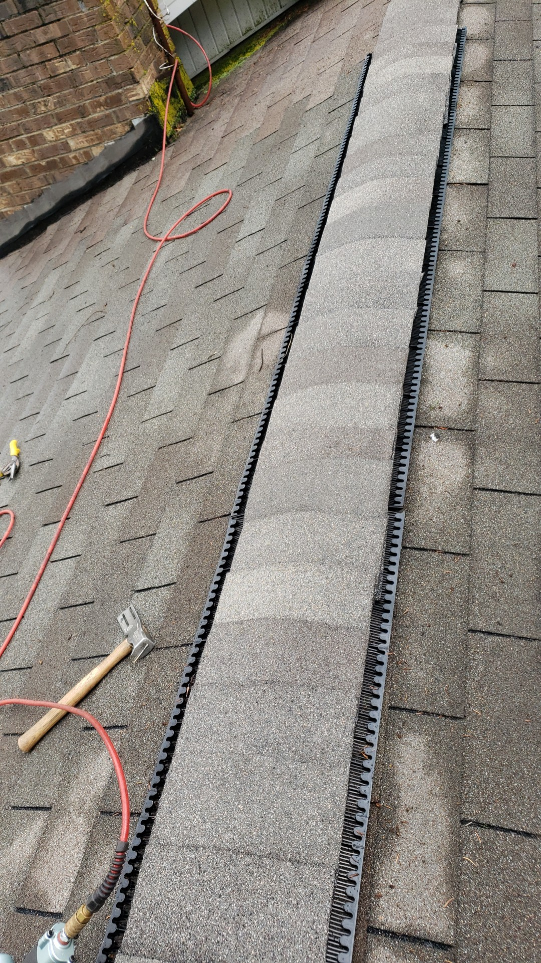 This is the image of the newly installed ridge vent and ridge cap shingles.