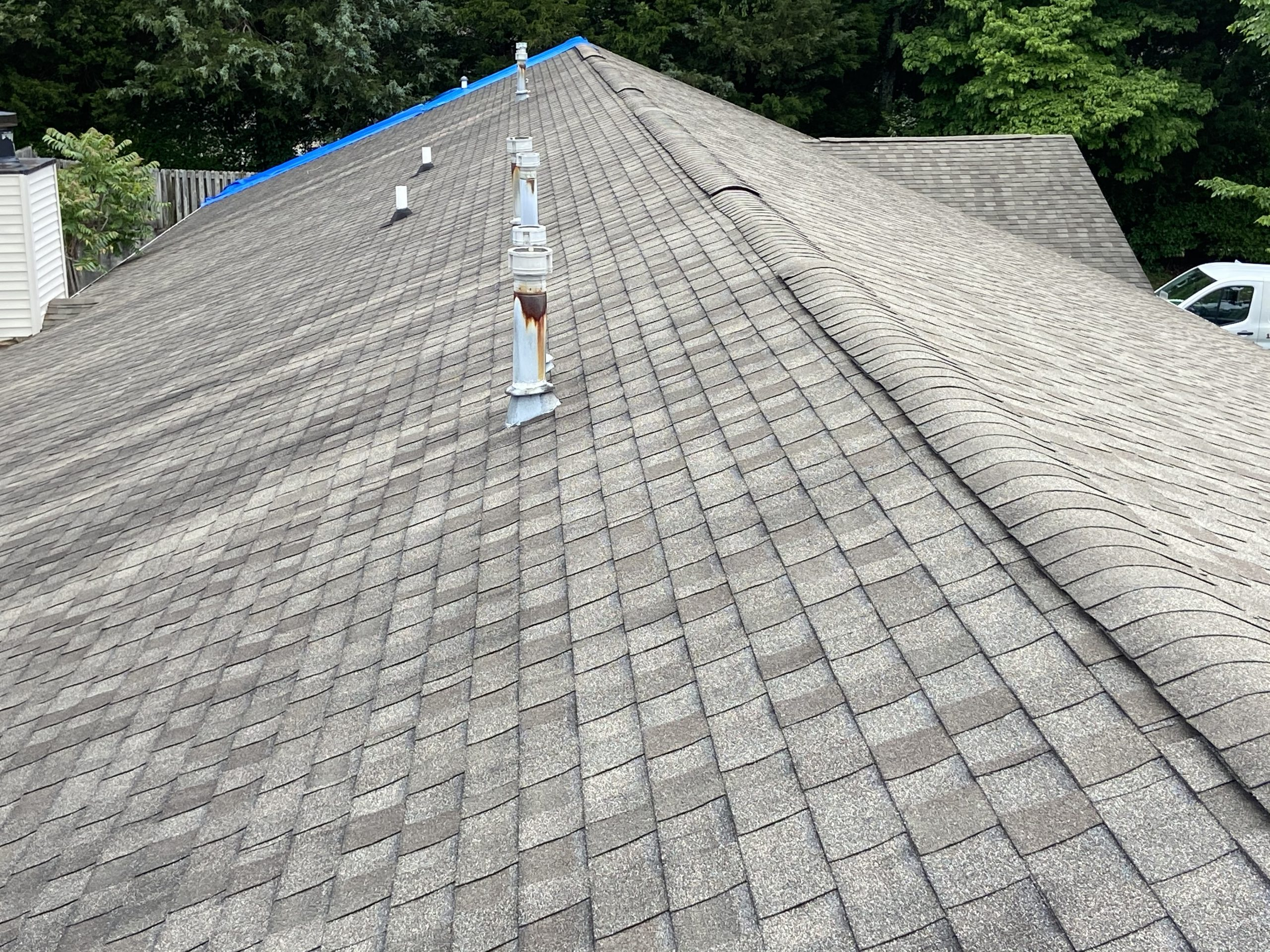 This is an image of a roof at the ridge showing the roof is in bad condition.