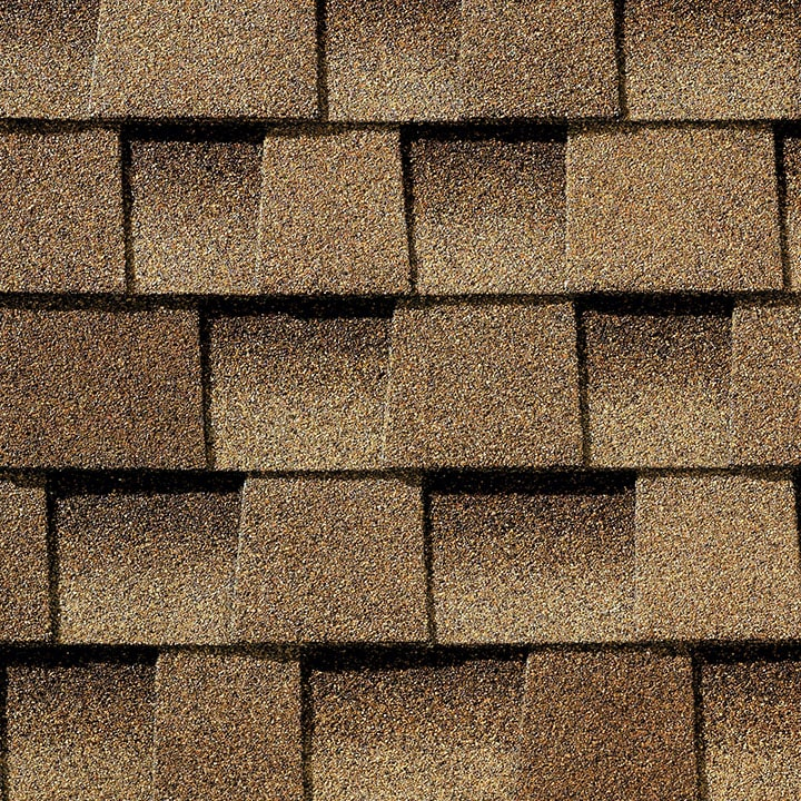 This is an image of weathered wood GAF Timberline HDZ shingles.