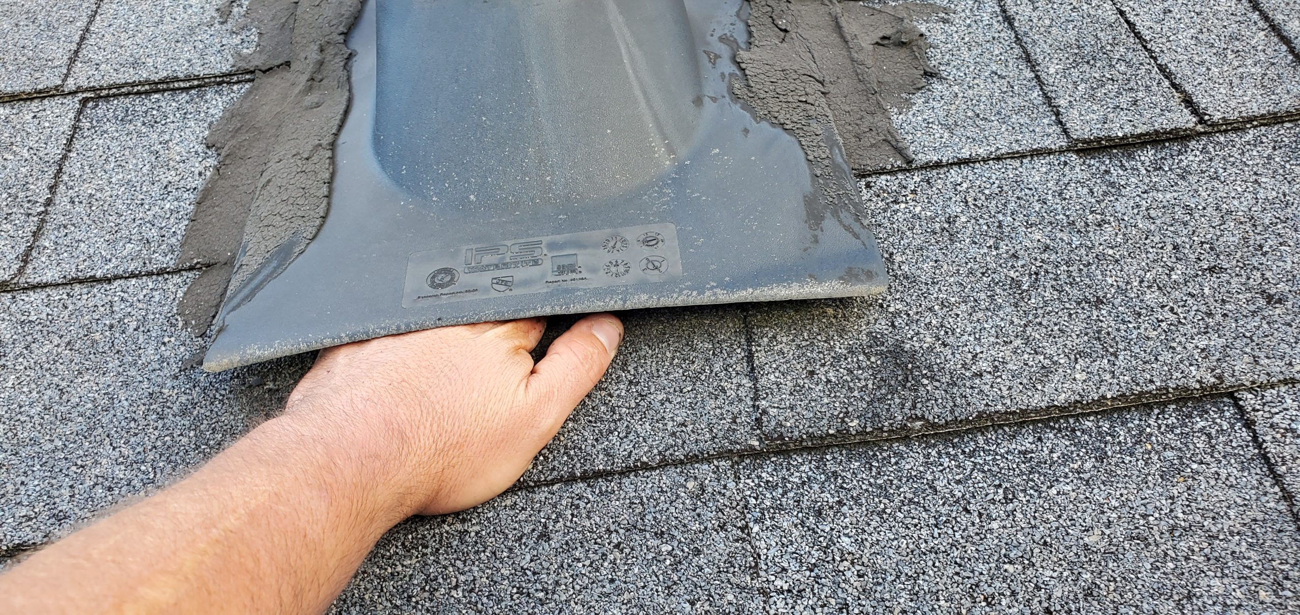 this pipe boot is not nailed correctly to this roof it looks to be held in place by caulk and roofing cement in sevierville