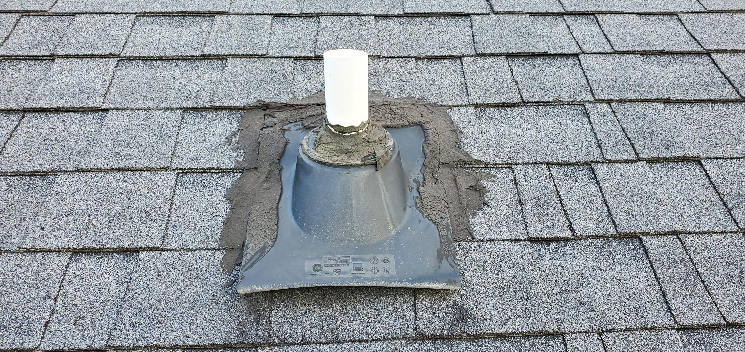 this is roofing cement holding an old pipe boot in place that was mis installed in sevierville tn