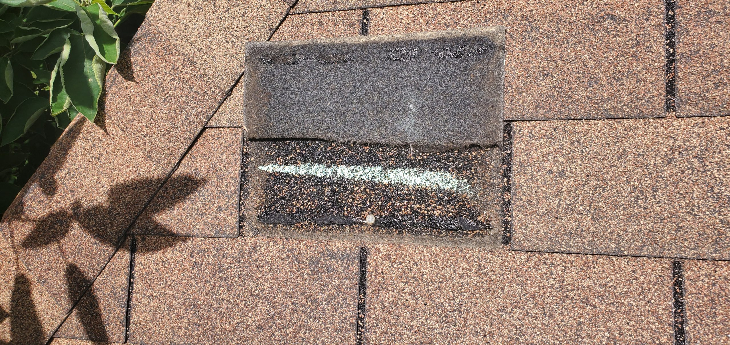this is a shingle that has flipped back and is wind damaged in knoxville tn