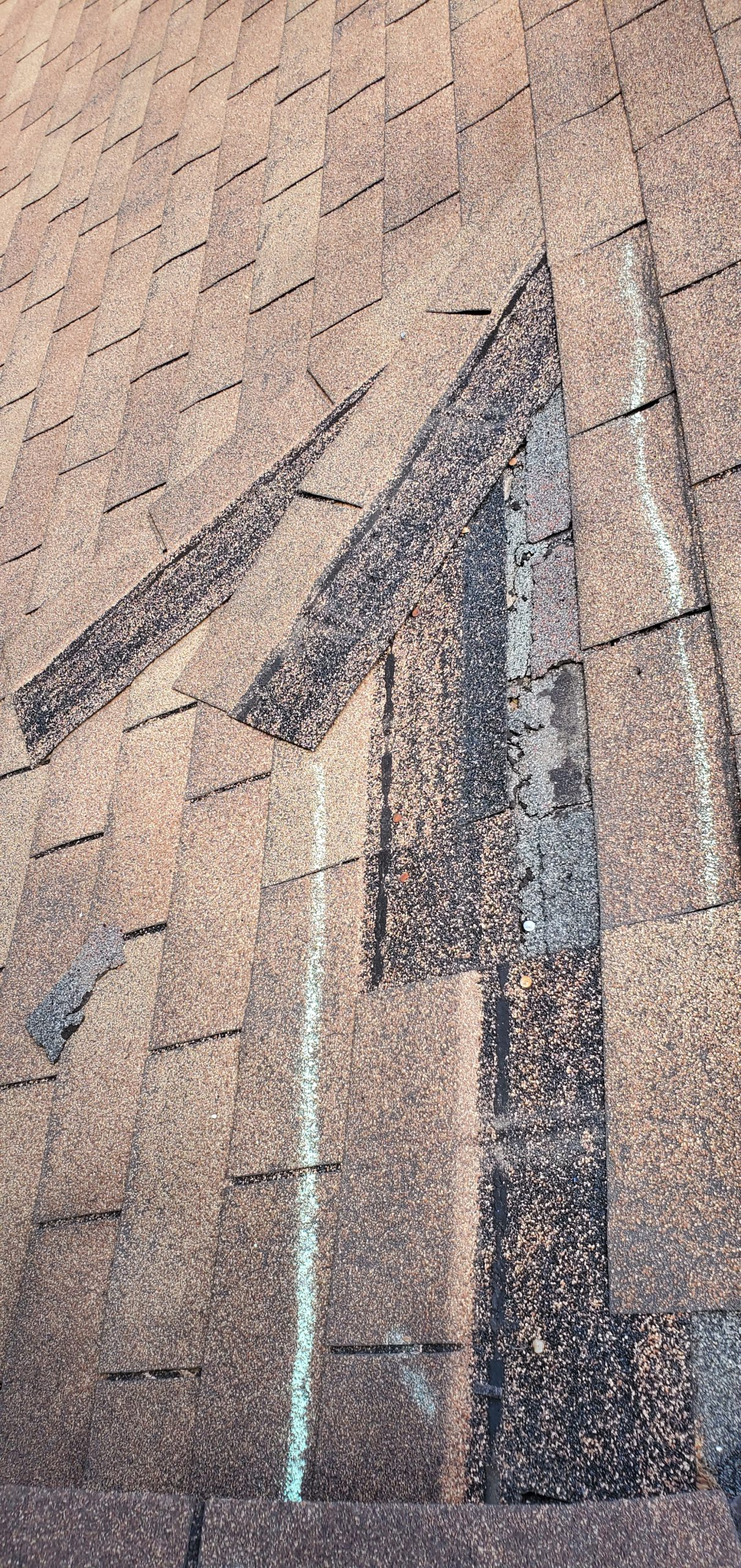 this is a picture of shingles that are blowing off of a roof in knovxille tn