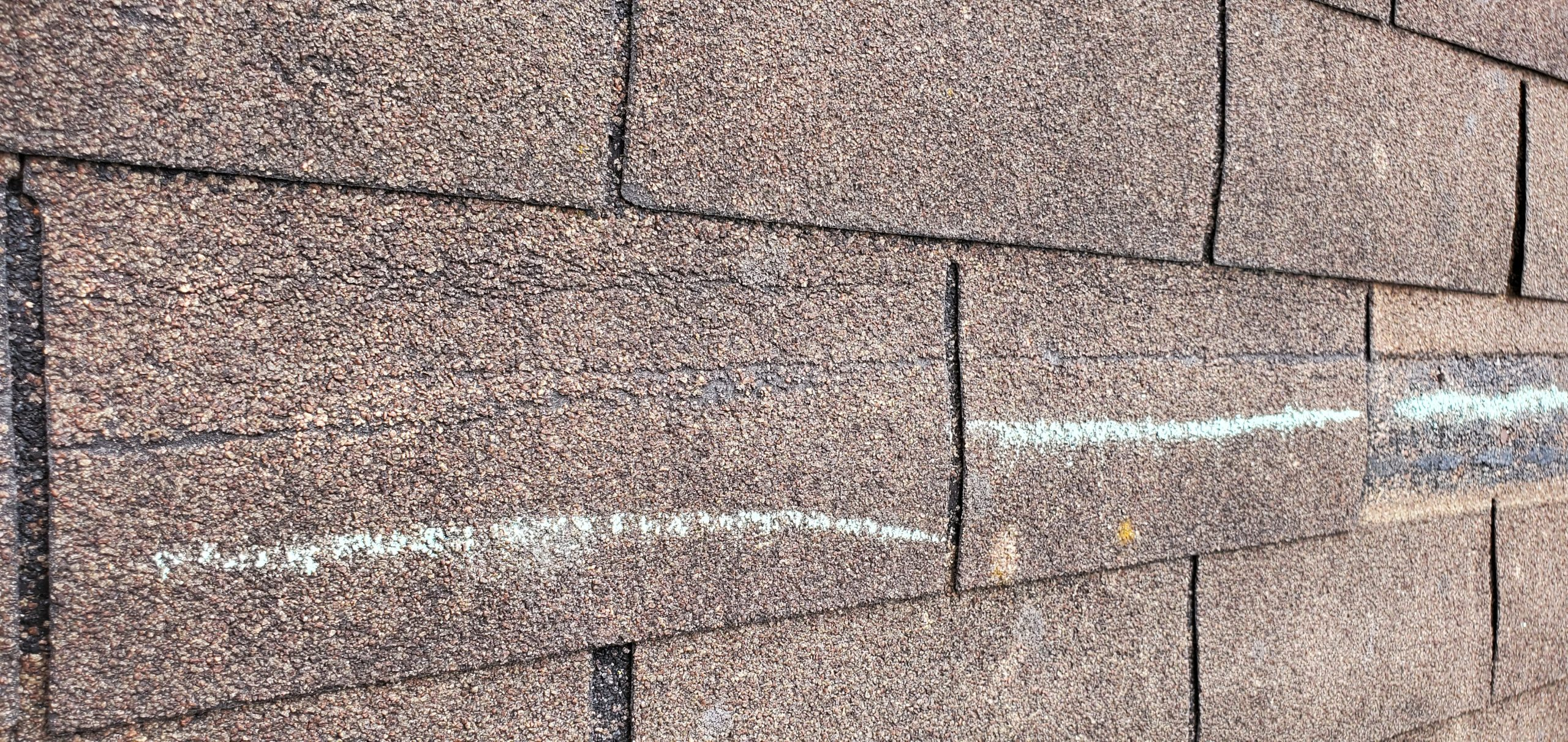 this is another picture of a cut along several shingles